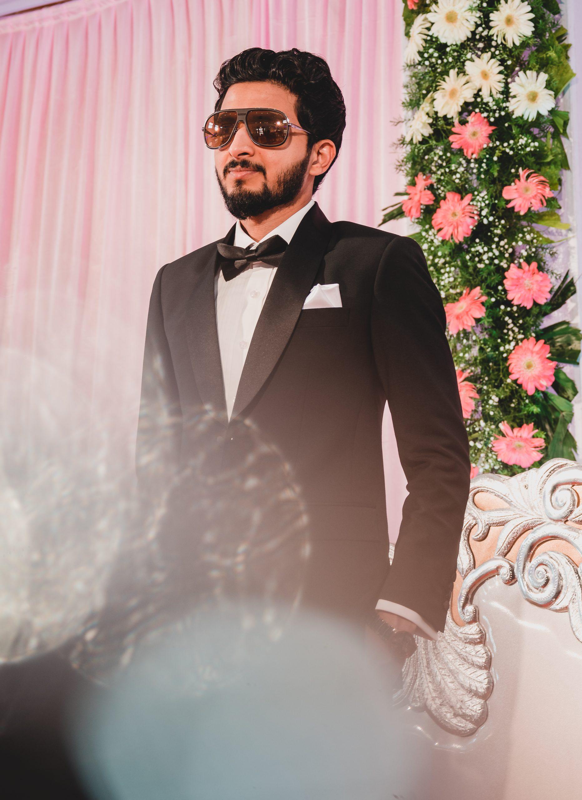 Groom posing in sunglasses