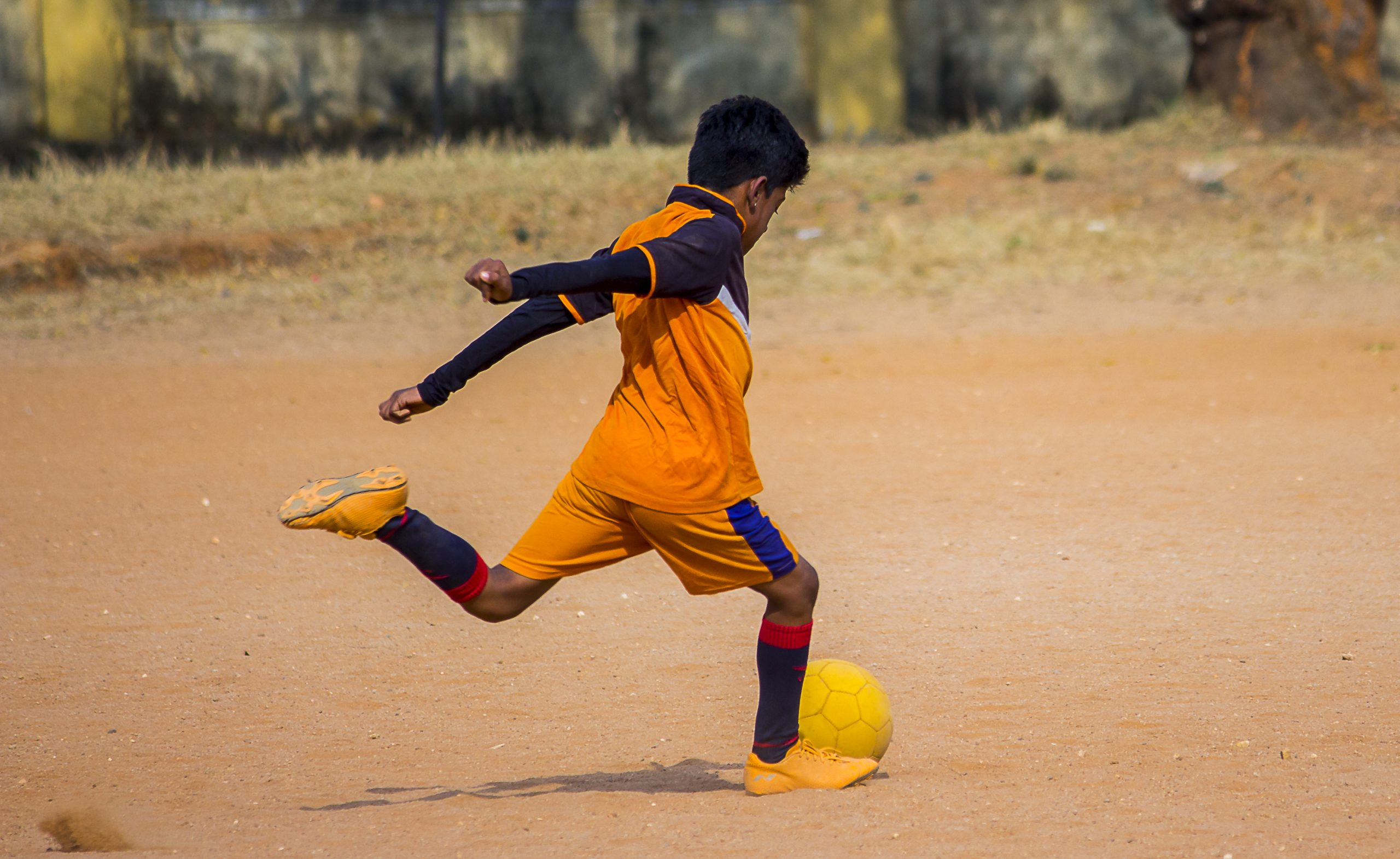 Indian boy playing football