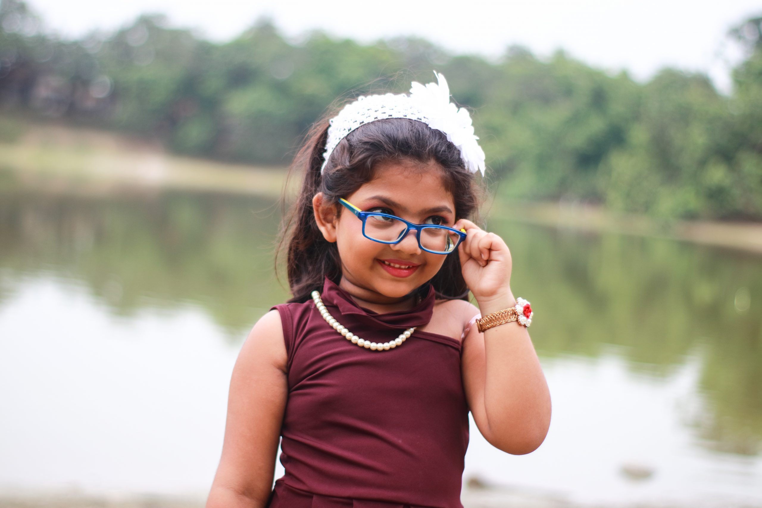 Little kid posing with specs