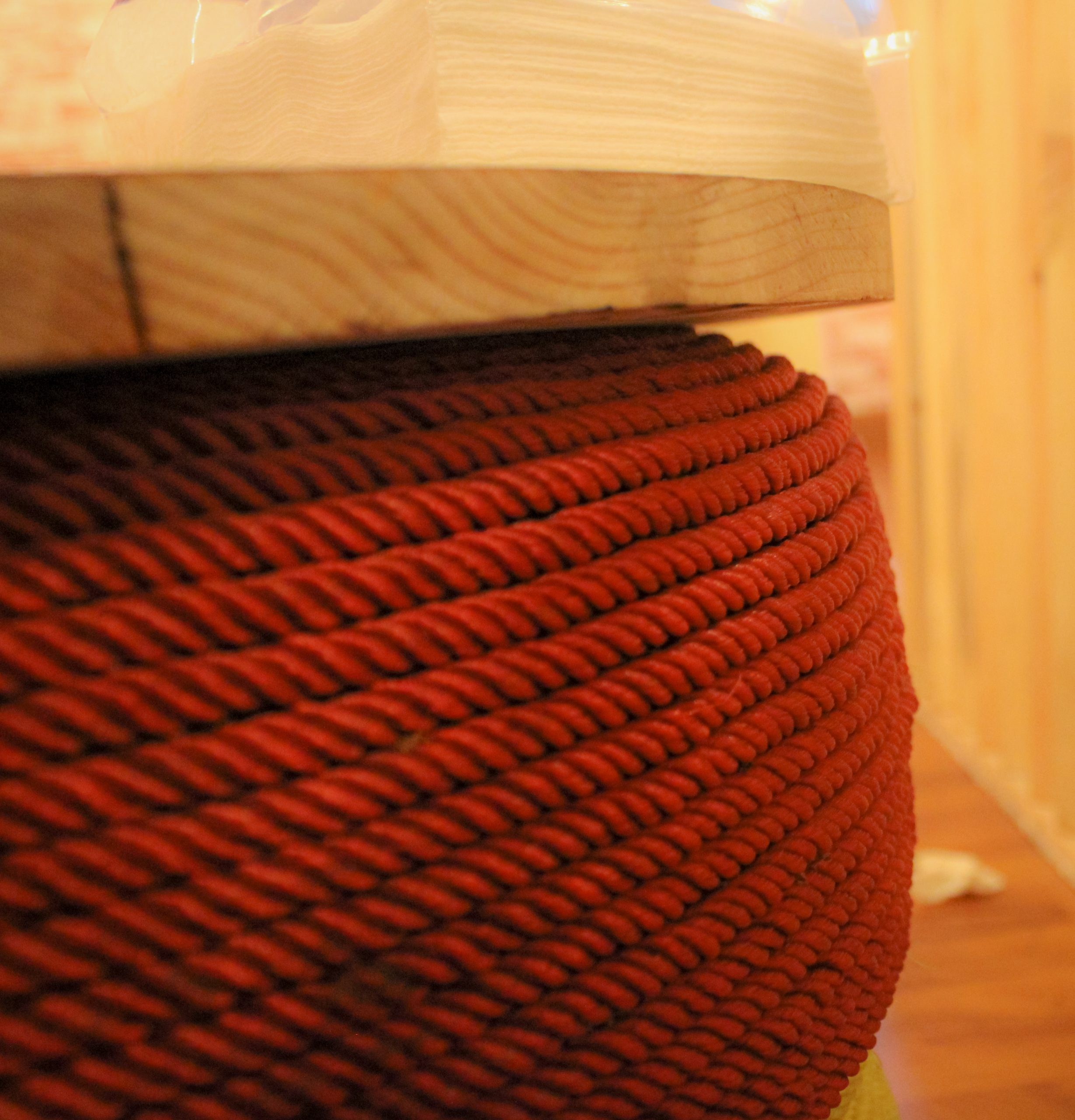 Red rope on wood