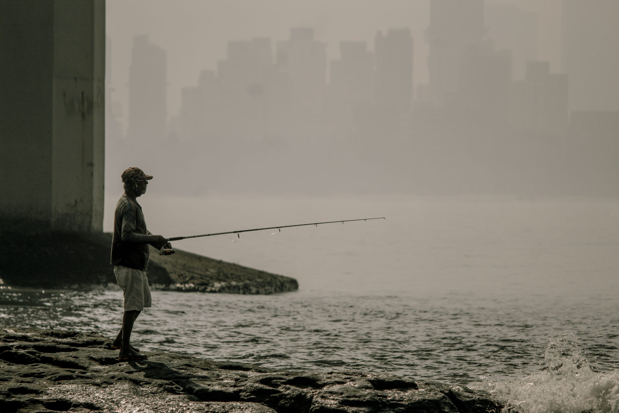 Man fishing in the Sea