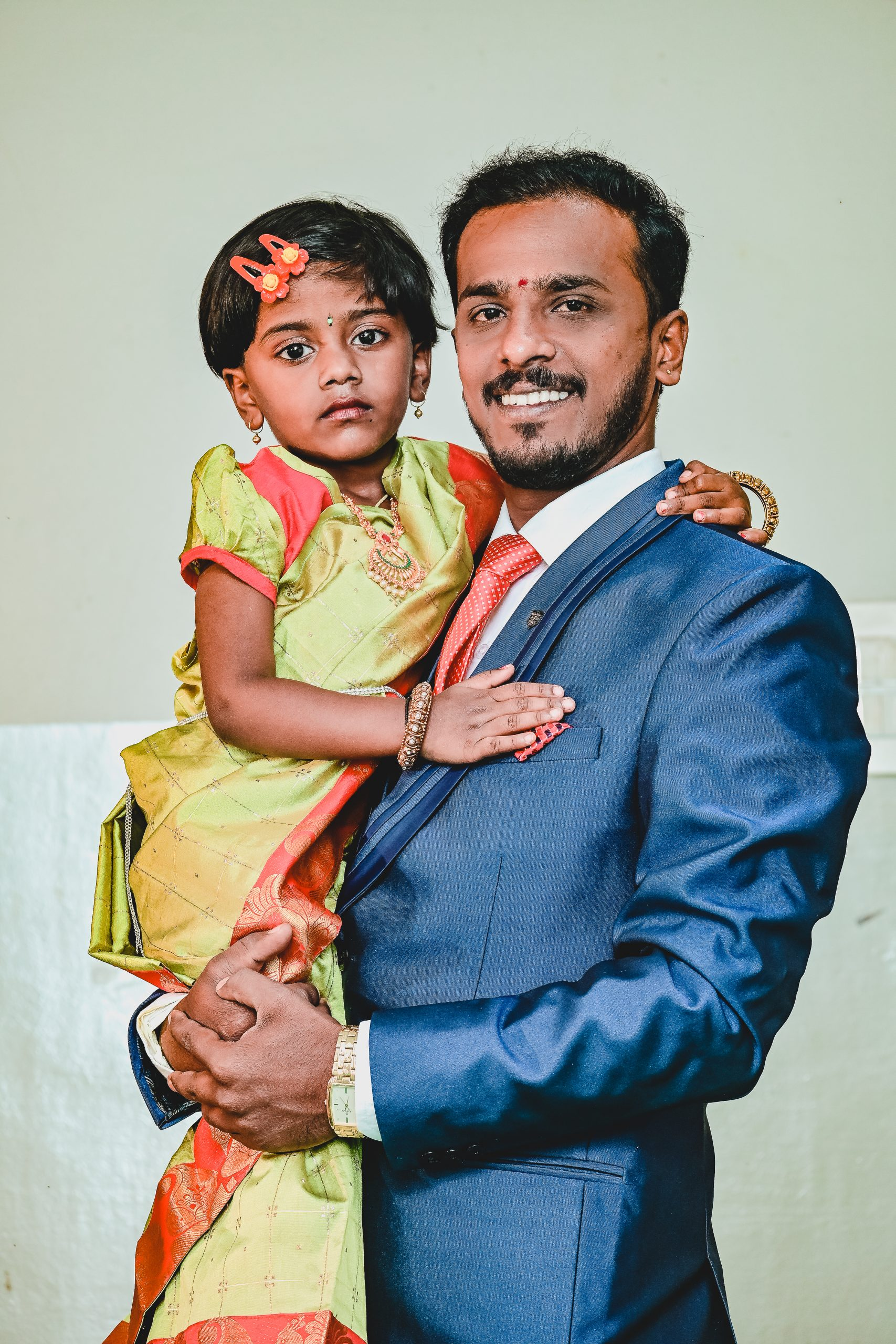 Man posing with little girl