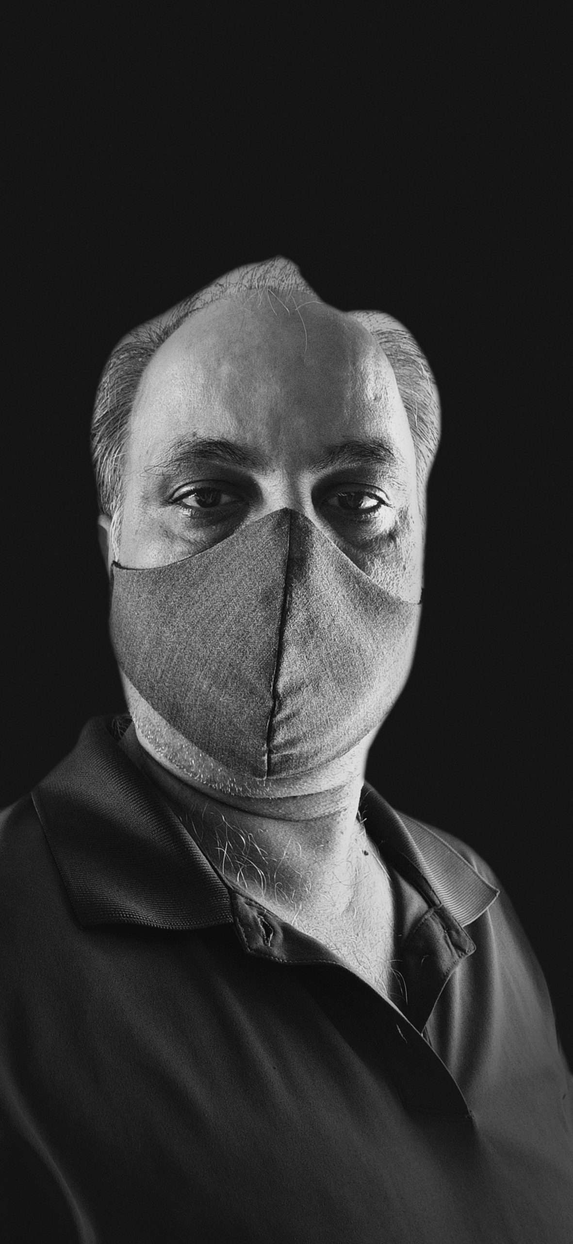A man with face cover