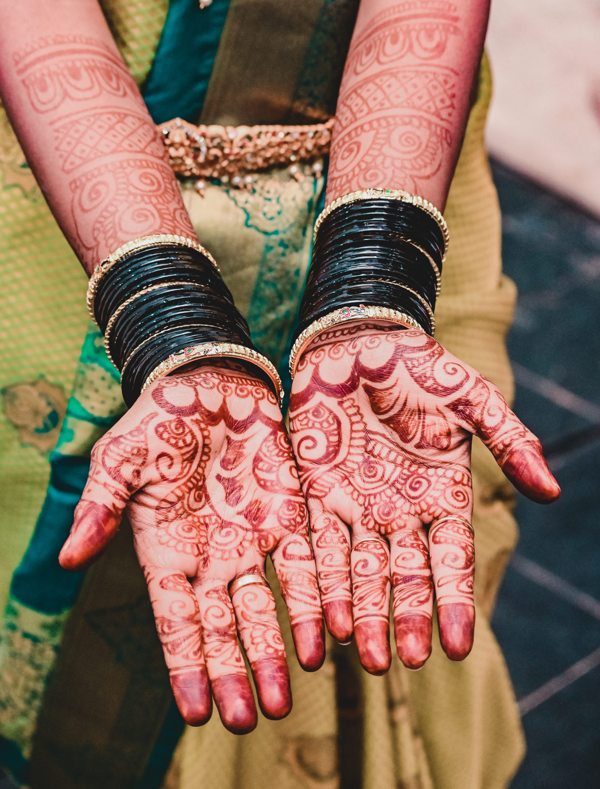 Mehndi design on a woman's hands
