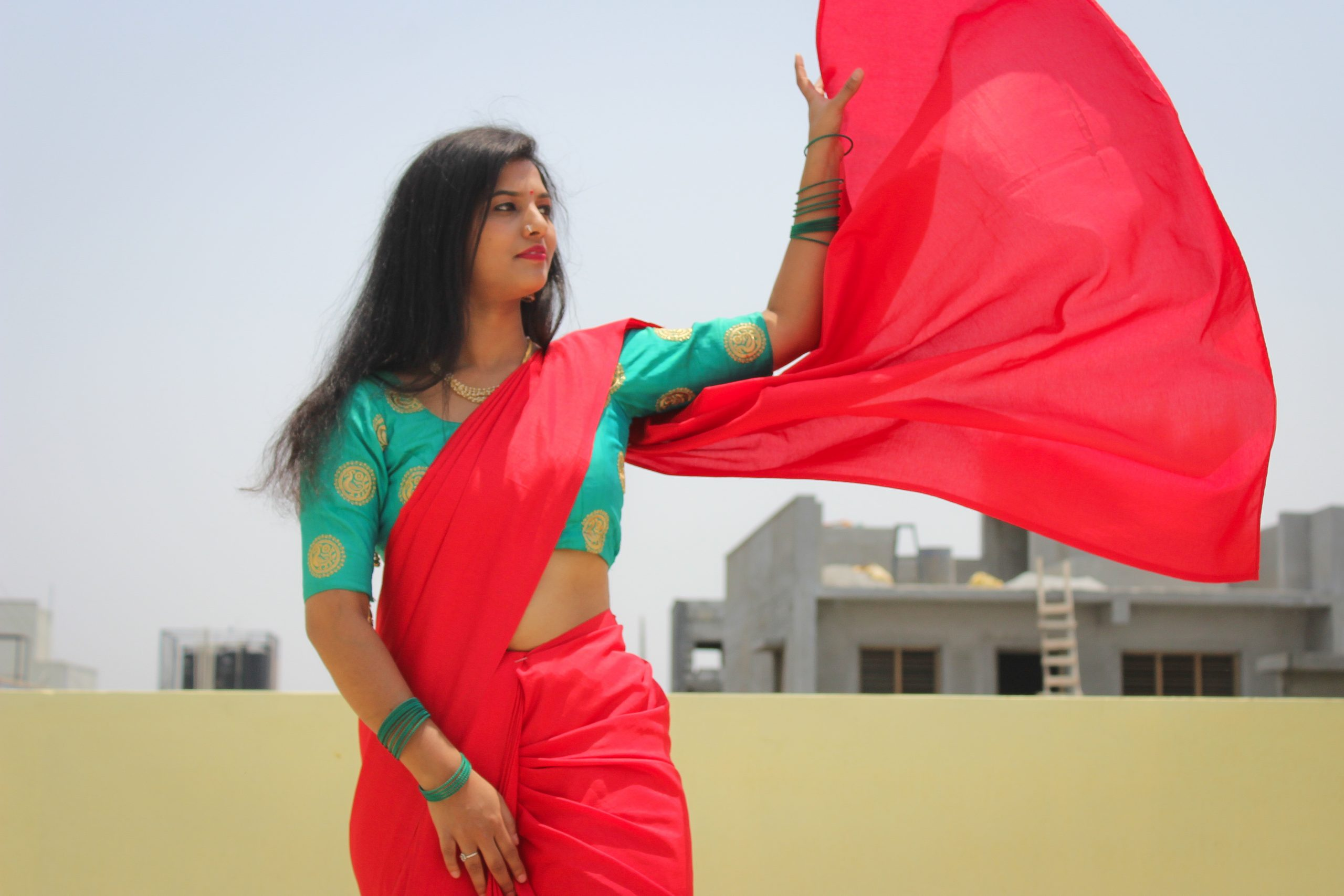 Model posing in a saree