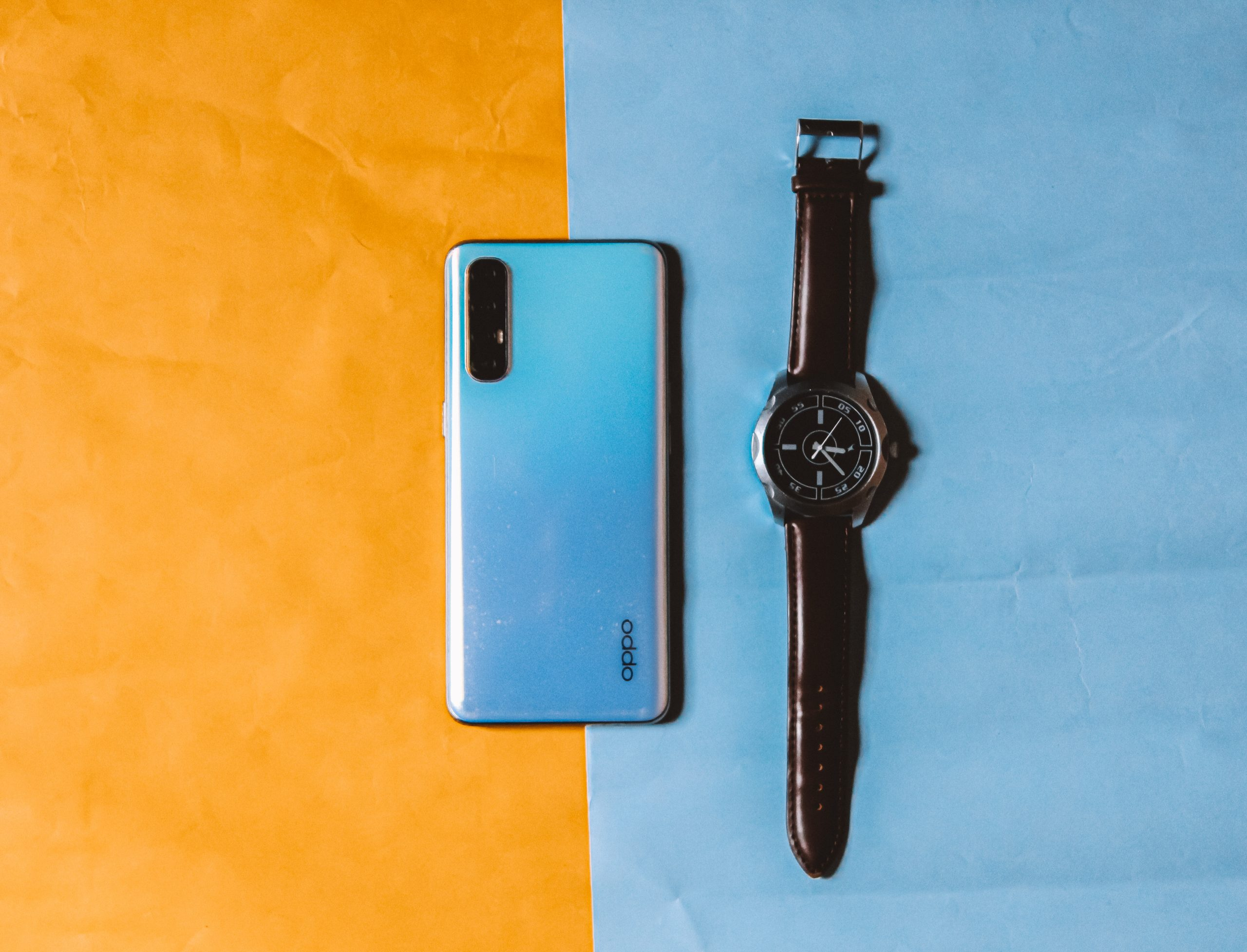 Oppo smartphone and wrist watch