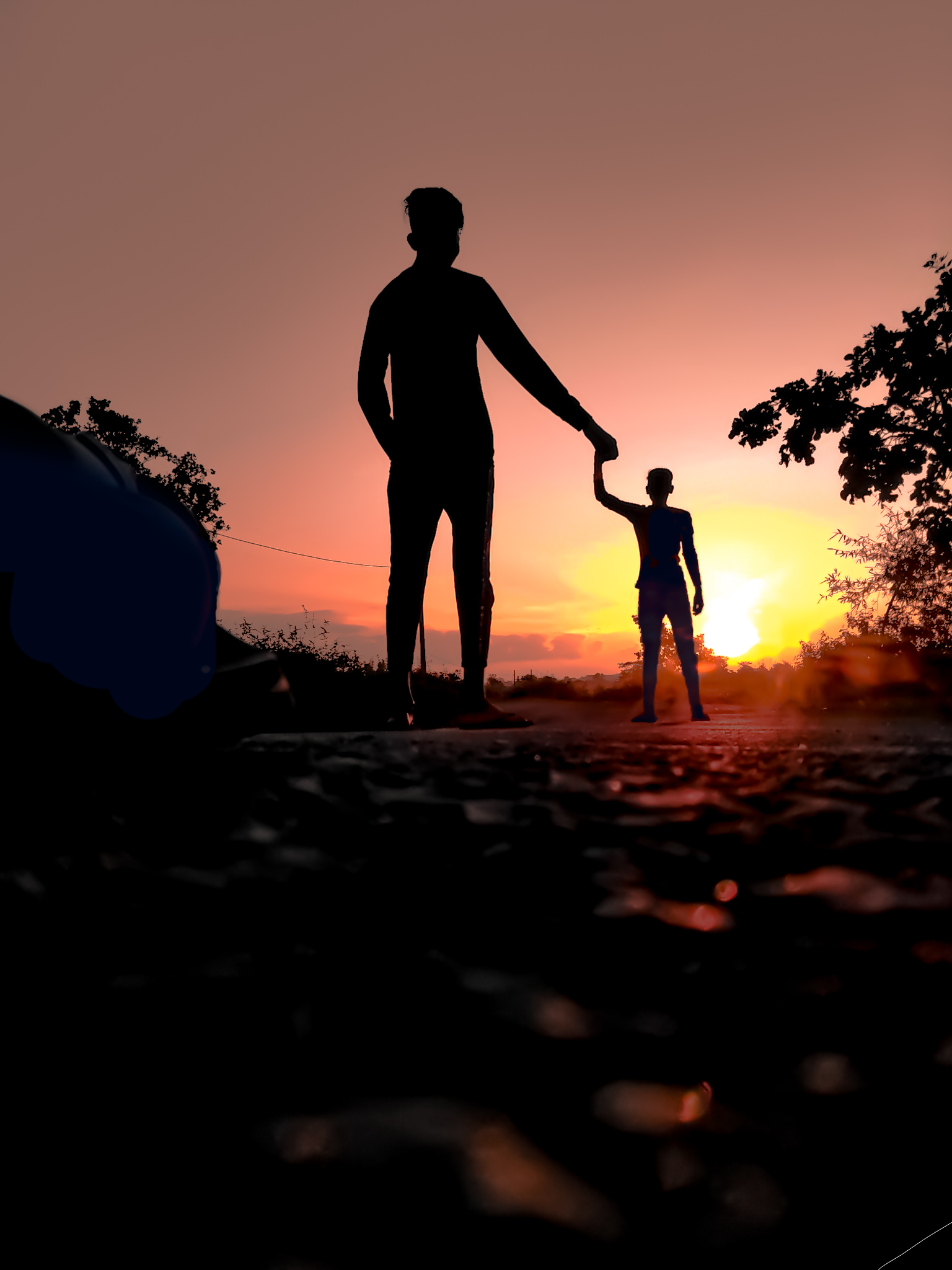 Boy with little boy in Silhouette