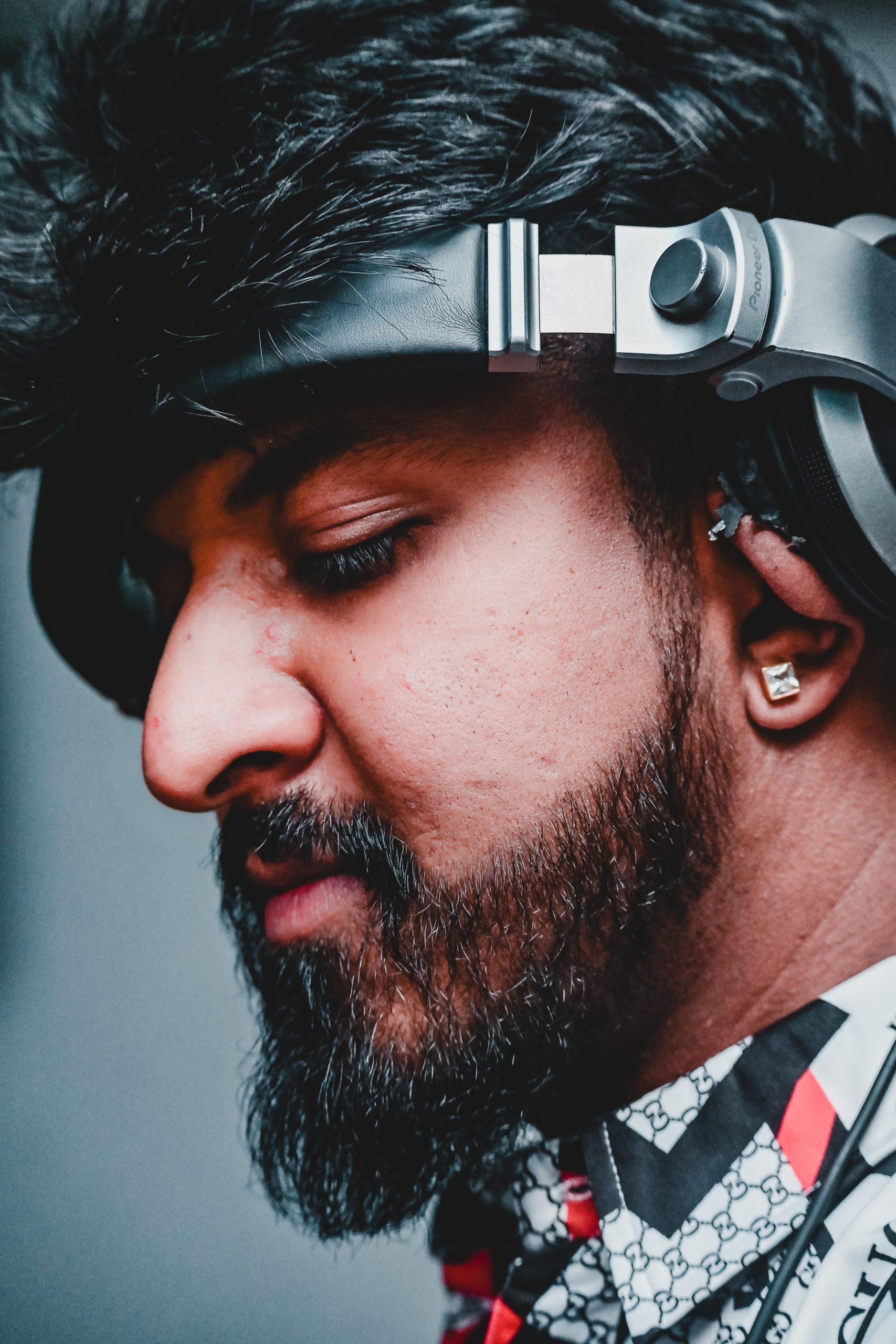 Stylish boy posing while wearing headphones