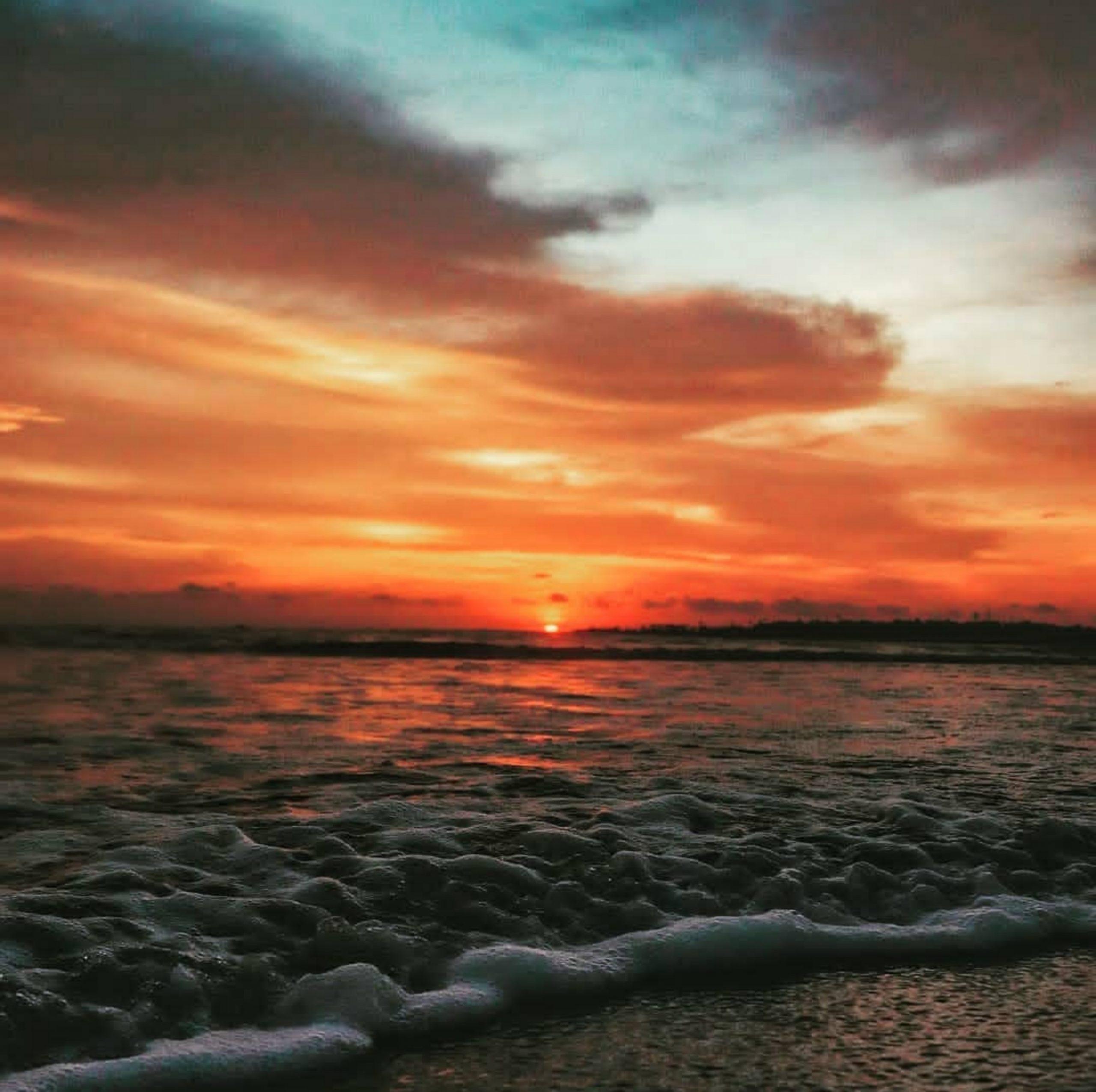 Sunset through a beach