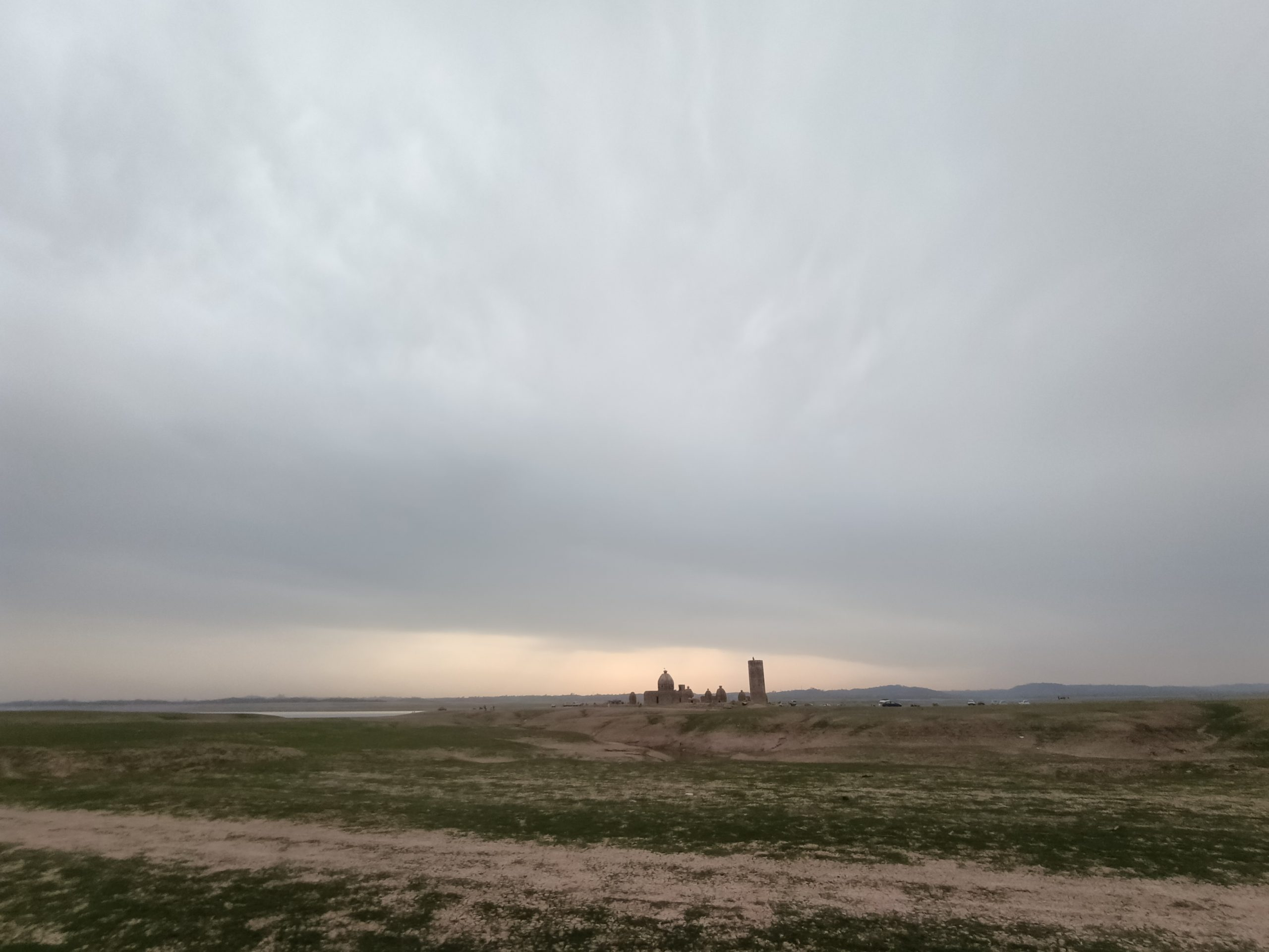 Land and cloudy sky