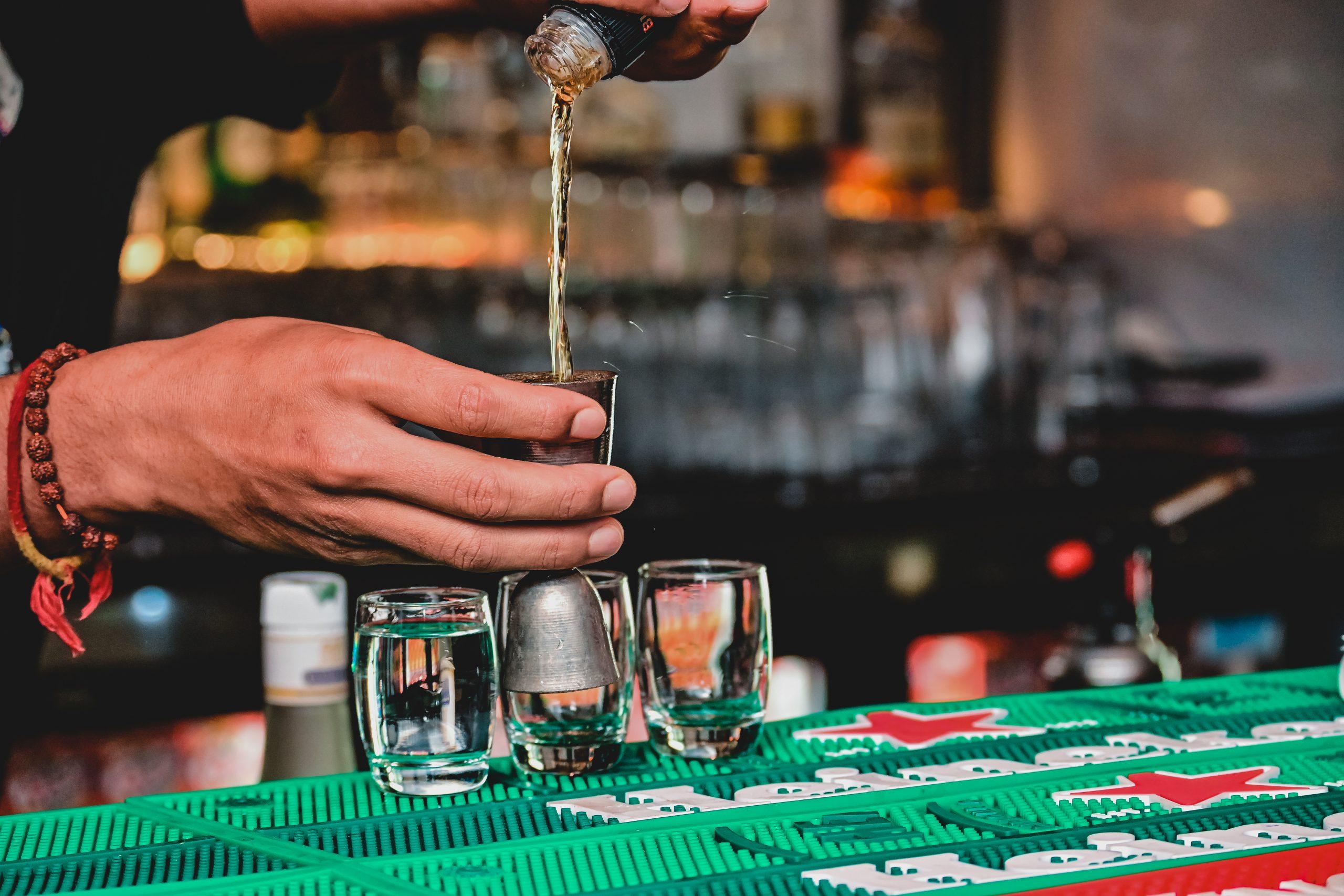 Bar tender making drinks