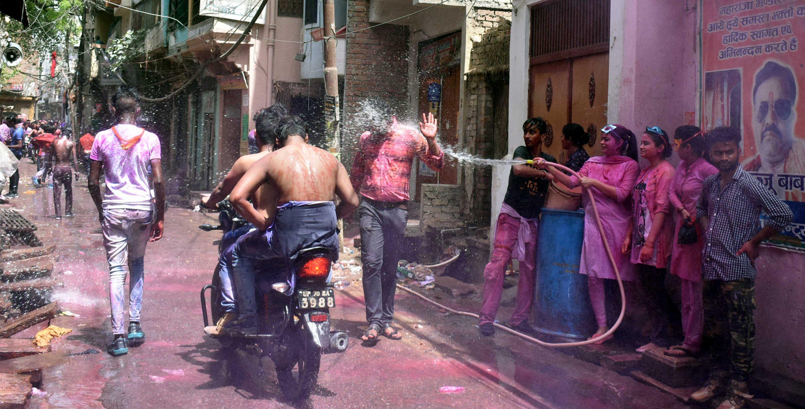 People celebrating Holi on street