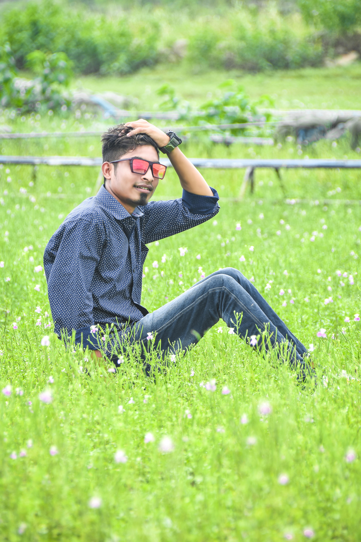A stylish boy posing in the farm
