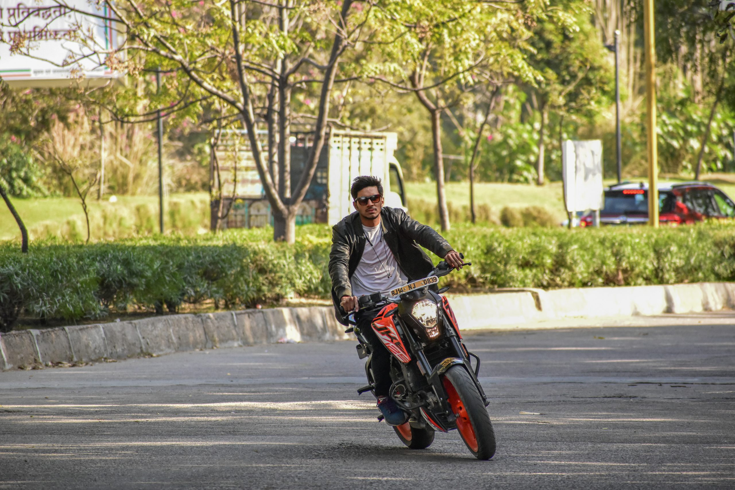 A boy riding a KTM Duke bike
