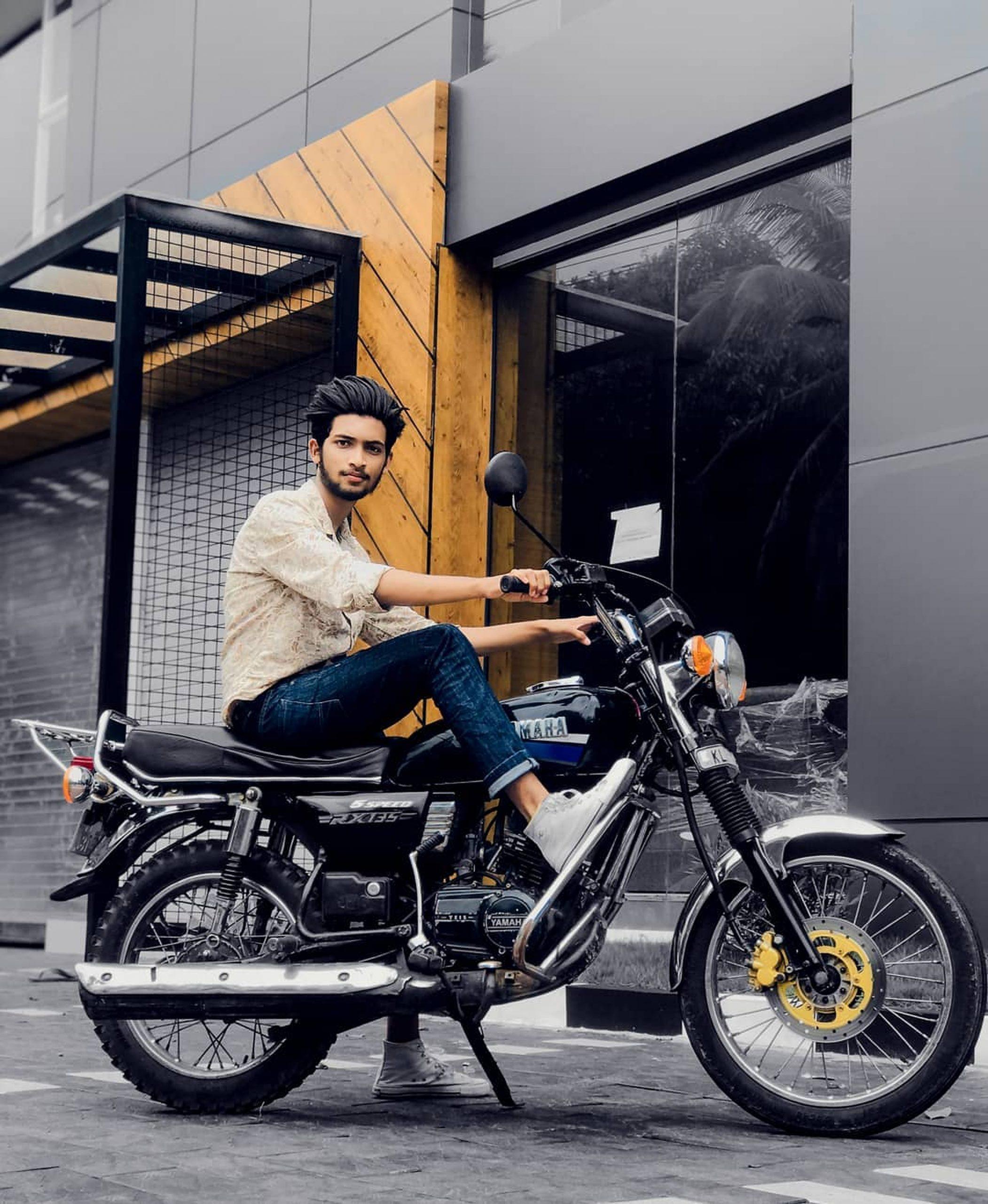 A boy sitting on a bike