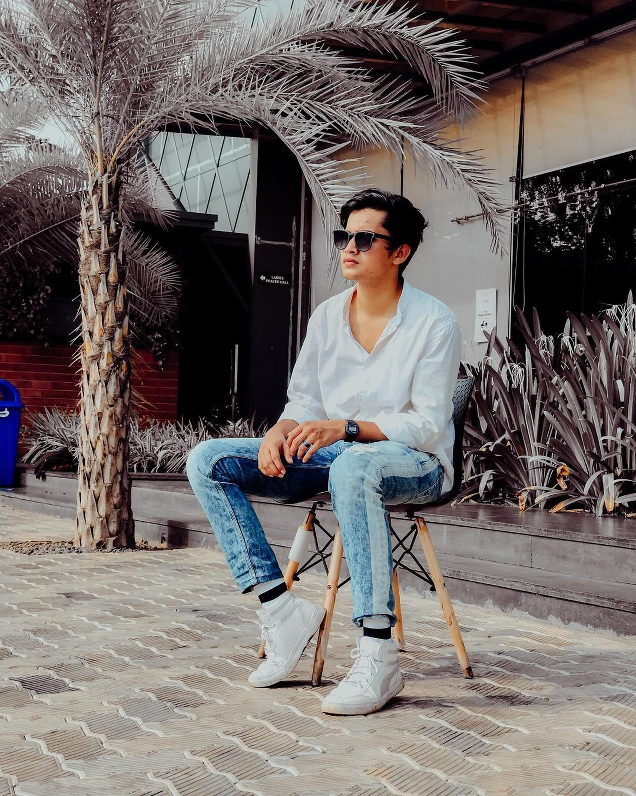 A boy sitting on a chair