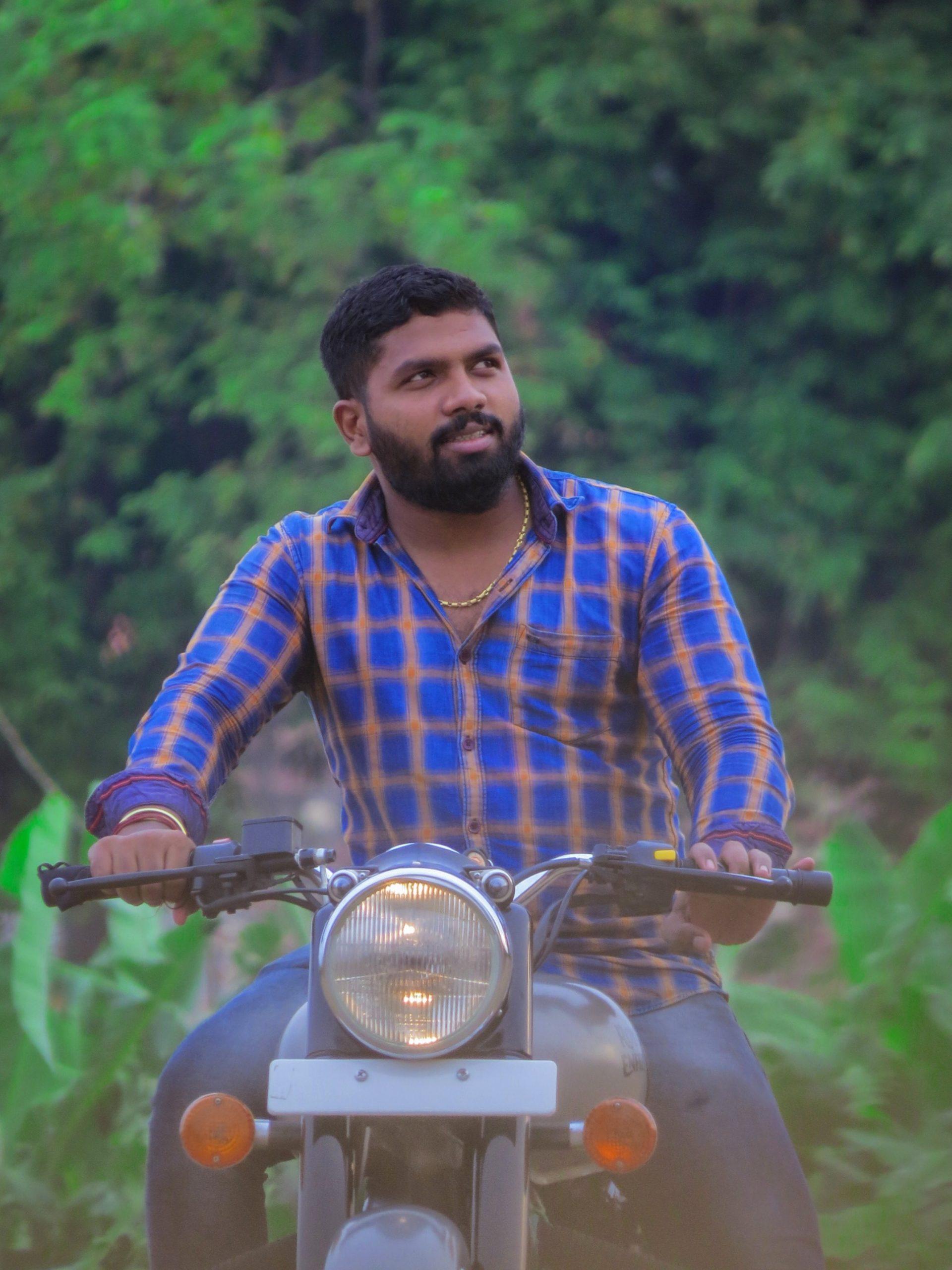 A man sitting on a bike