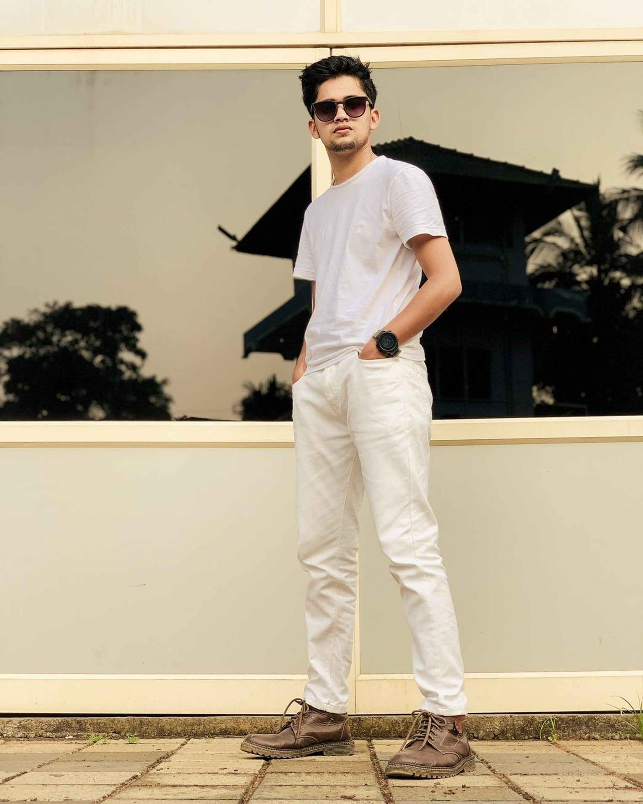 Stylish boy posing with sunglasses