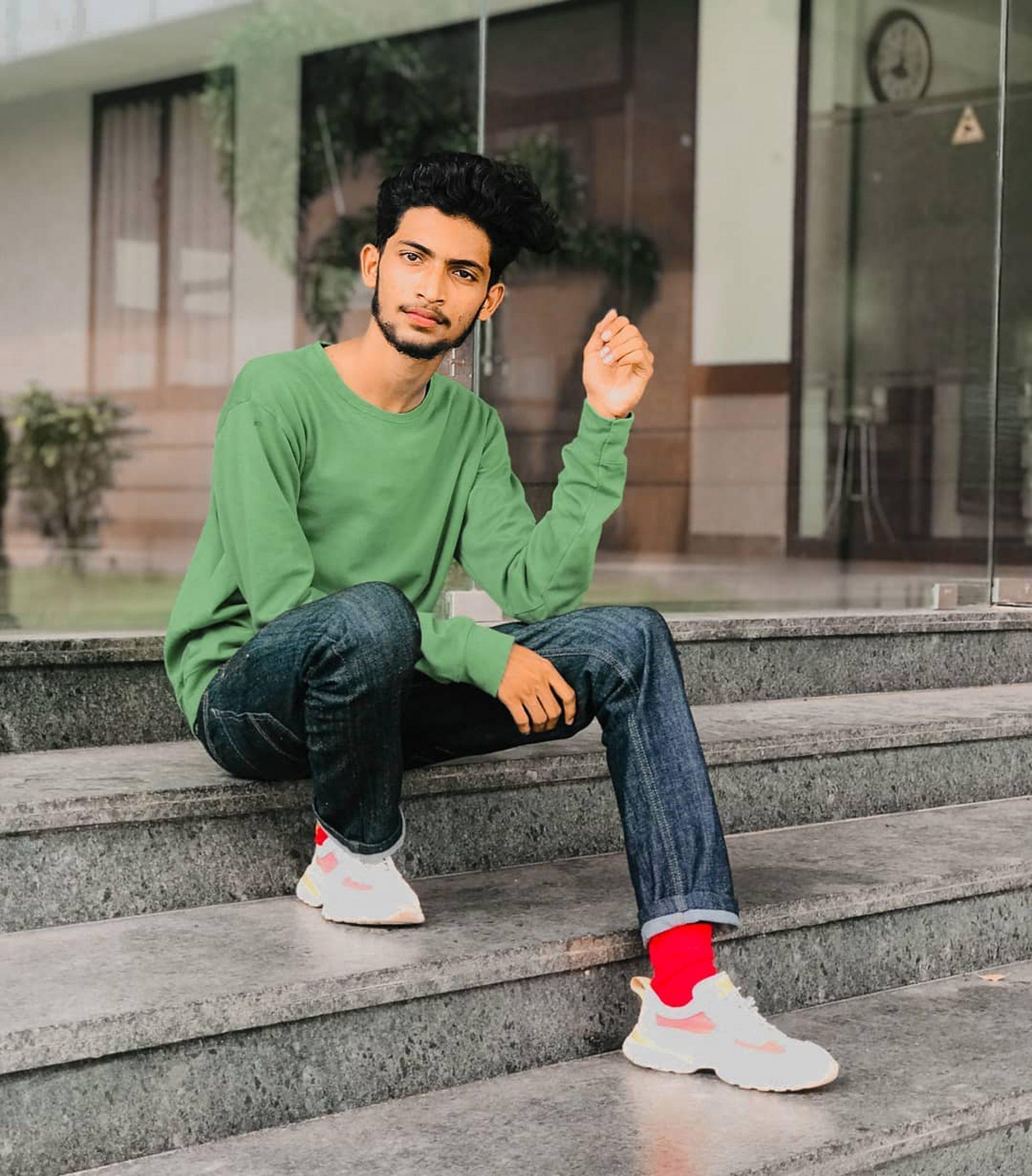 A stylish boy sitting on steps