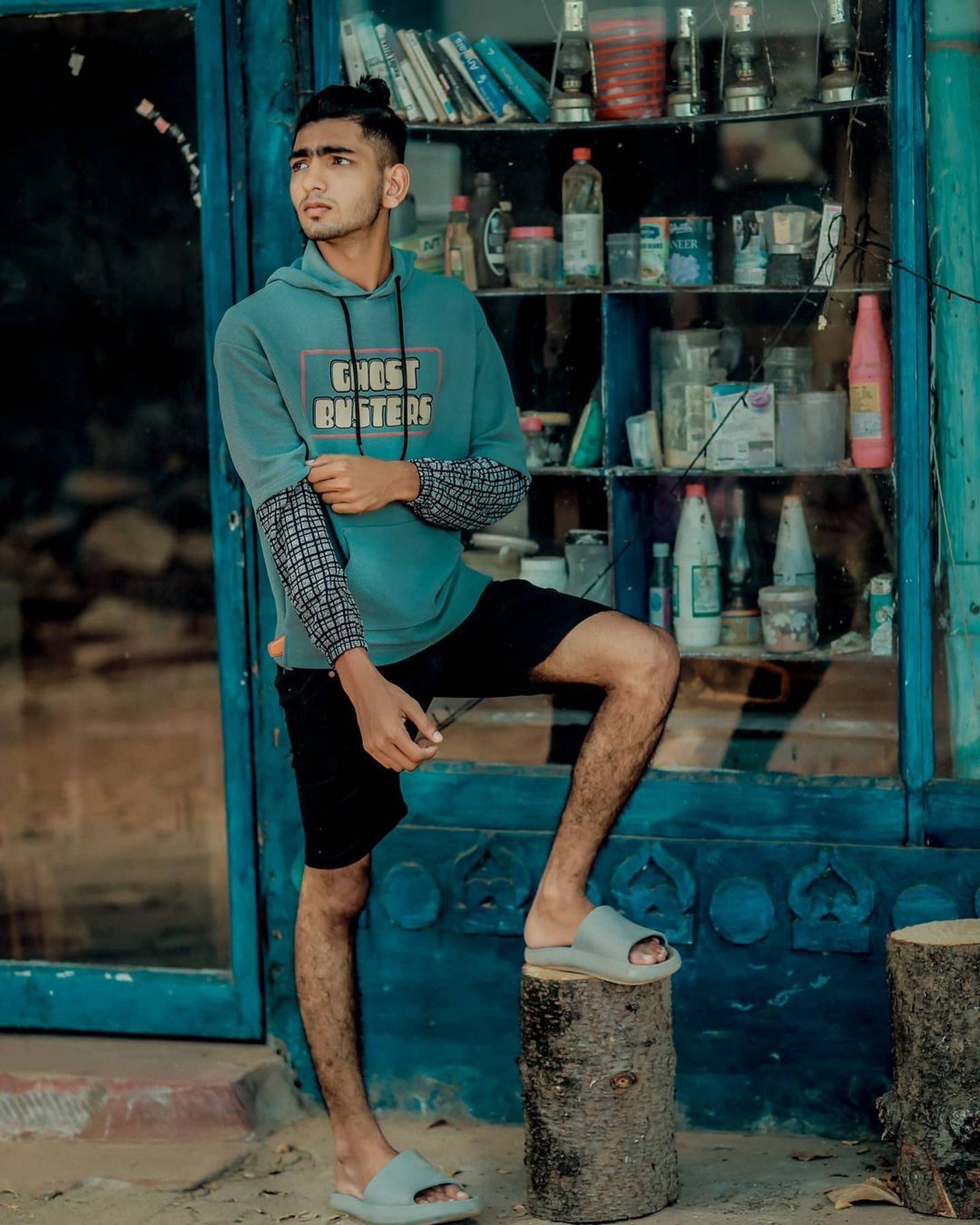 Boy posing outside stall