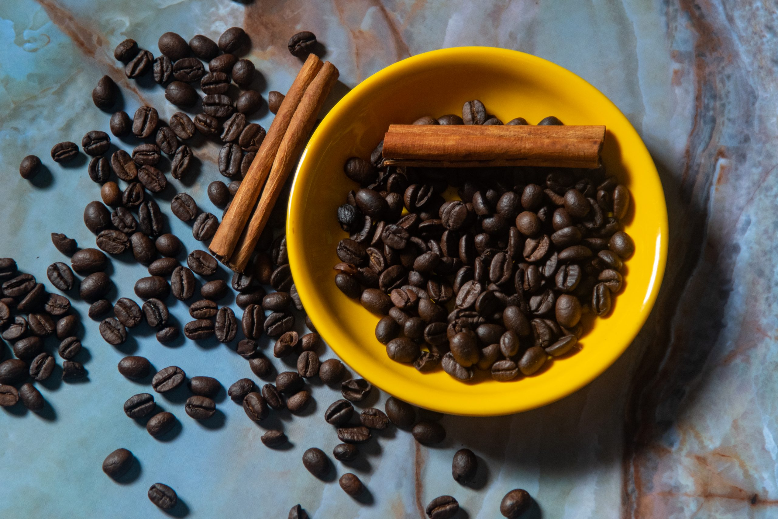 Coffee beans in the yellow cup