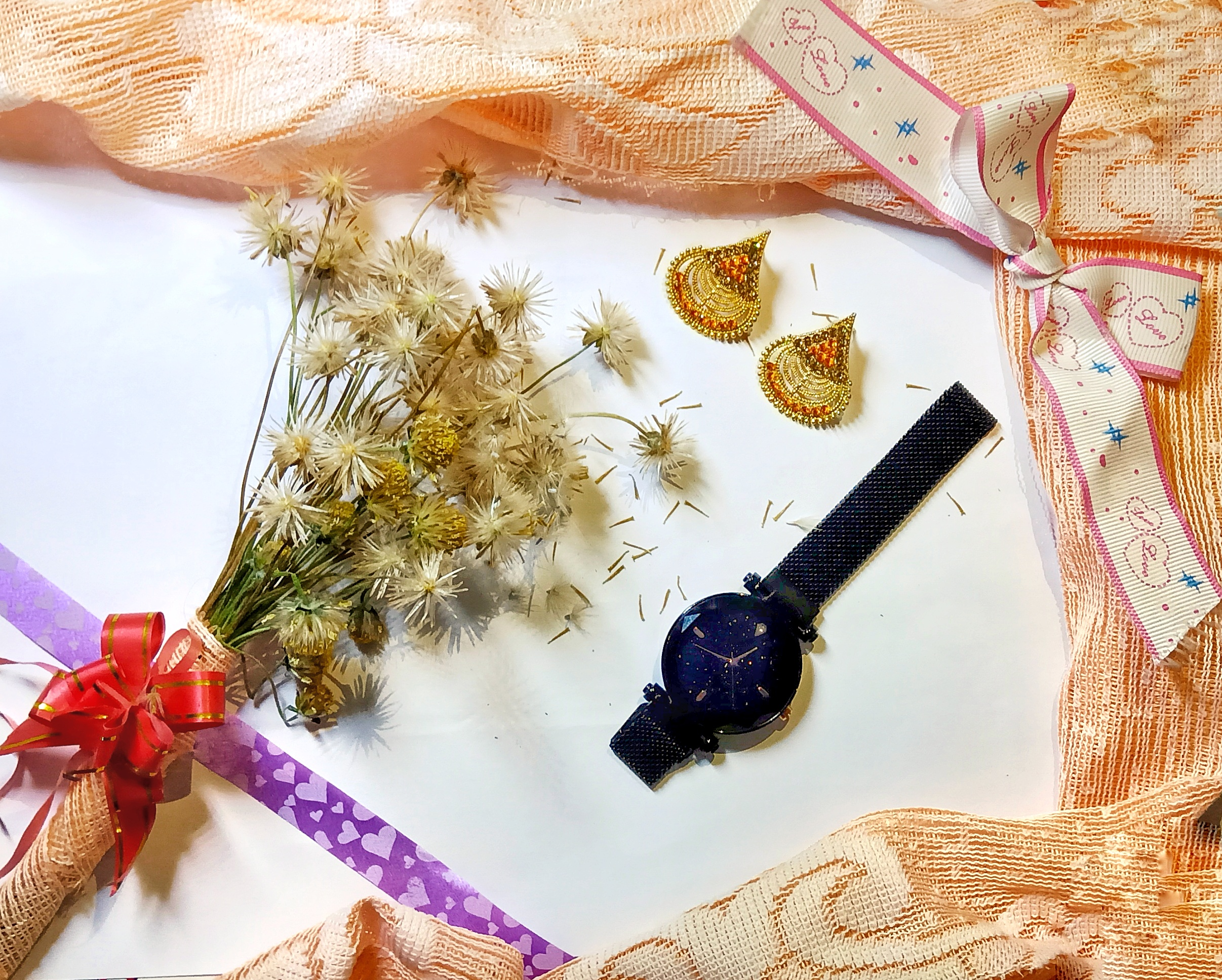 Flowers and a wrist watch