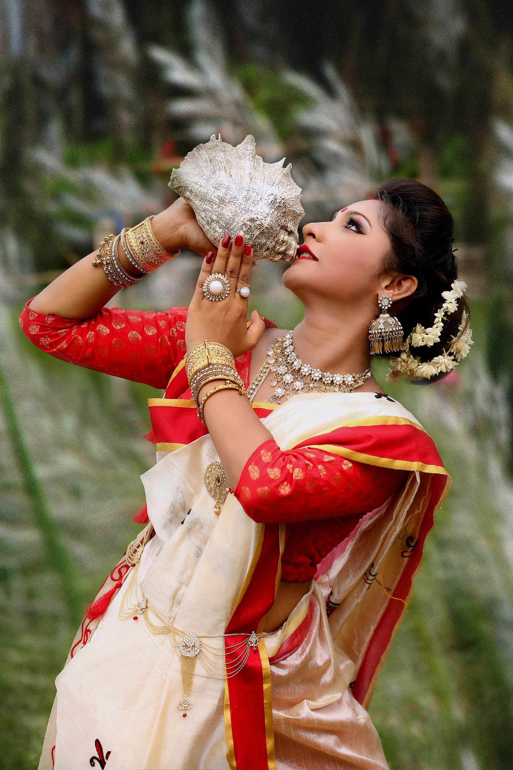 Girl playing Shankh