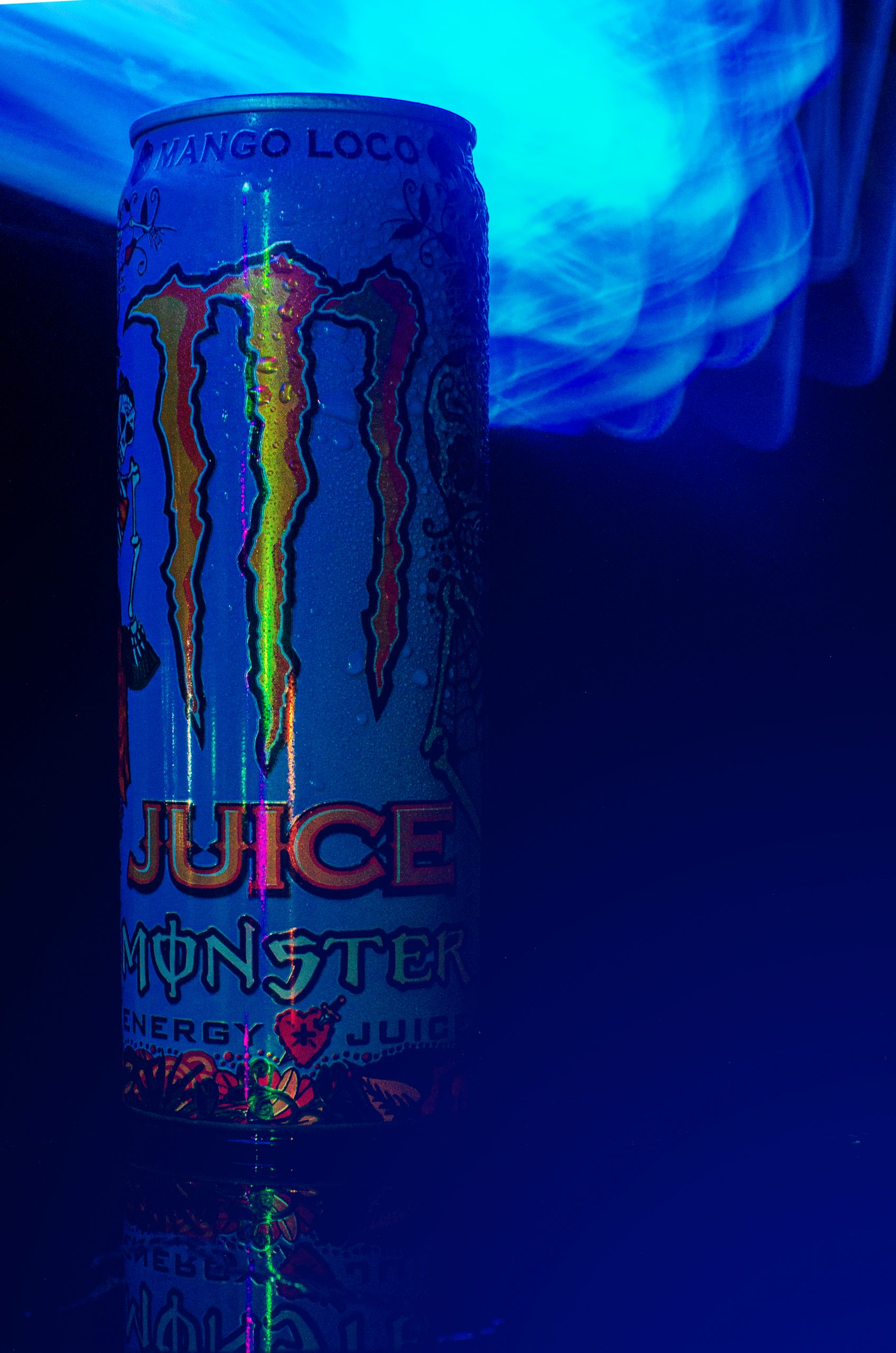 Monster energy drink can in blue light