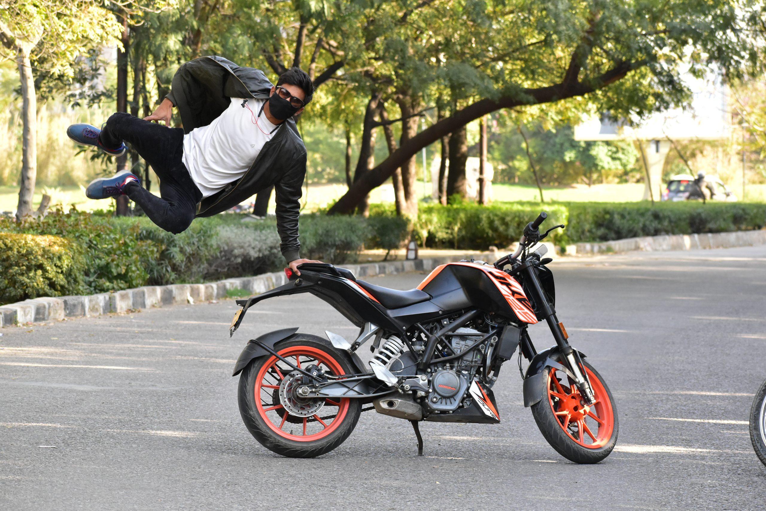 A boy jumping around a bike