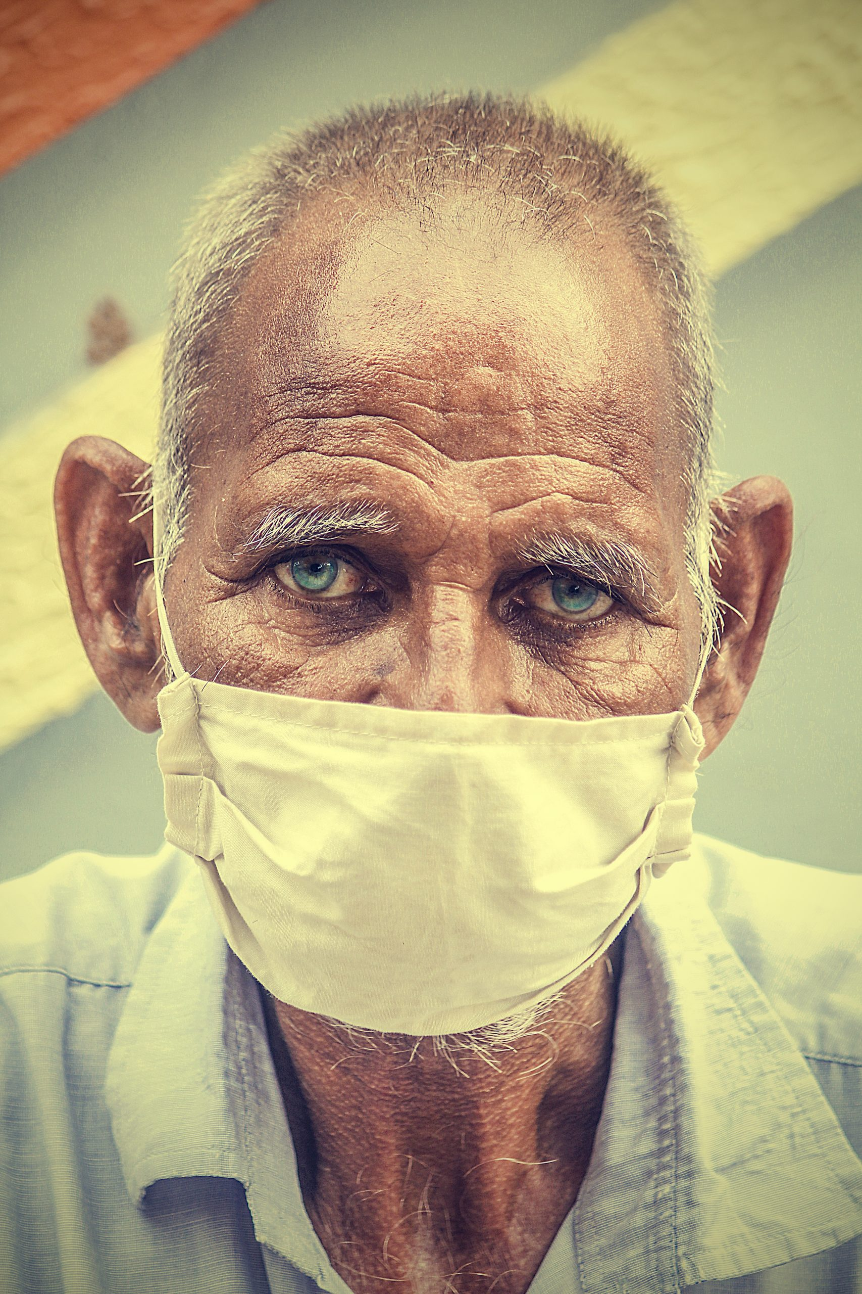 An old man with face cover