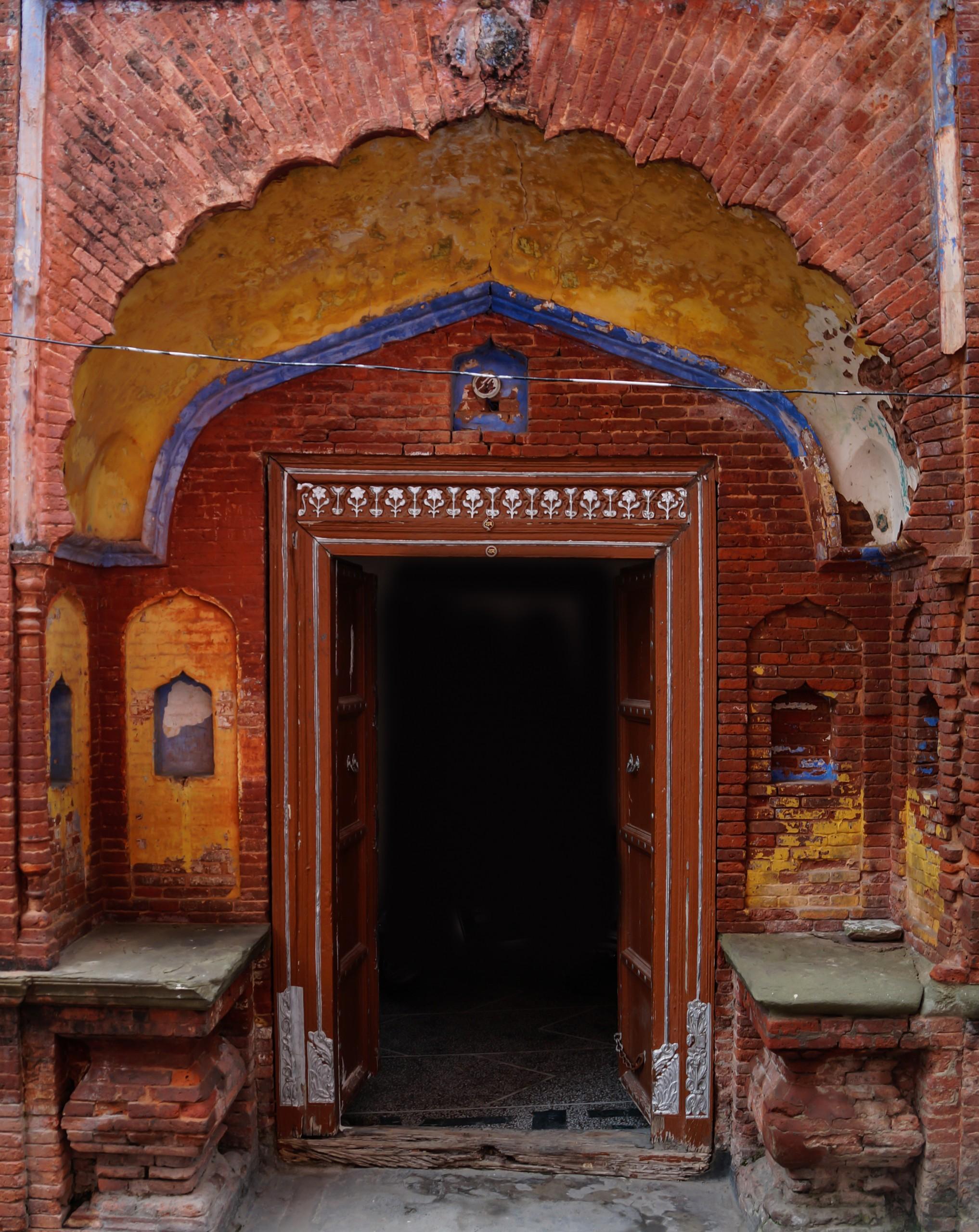 Vintage Door with Red Bricks